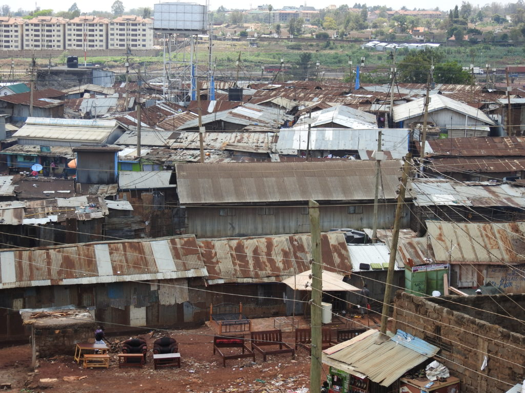 Kibera, with the city of Nairobi in the distance